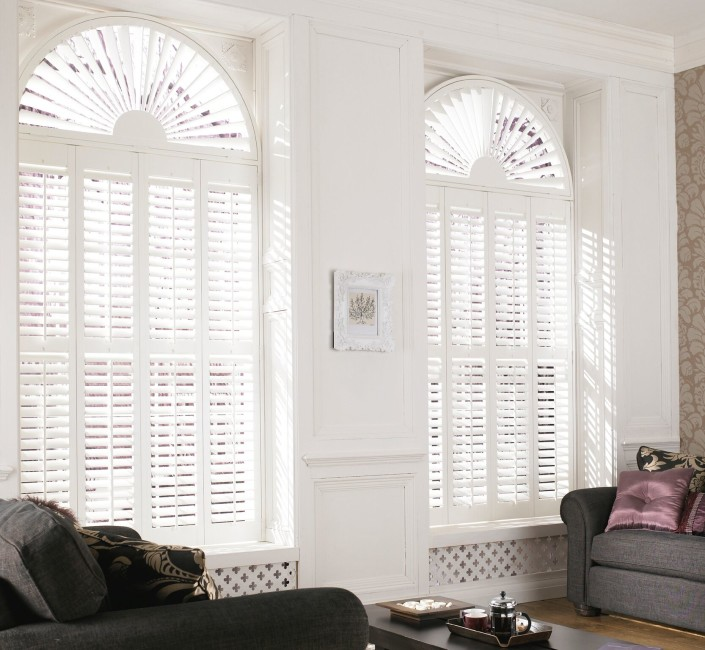 """shaped shutters tall window in white"""