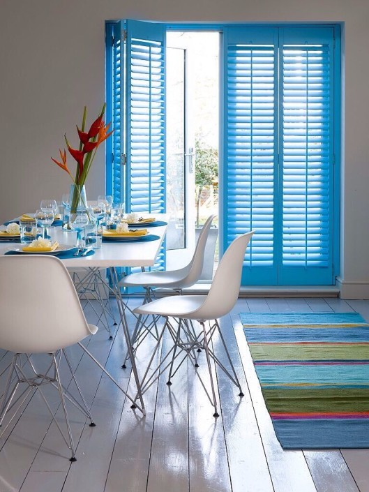 """bright blue shutters dining room"""