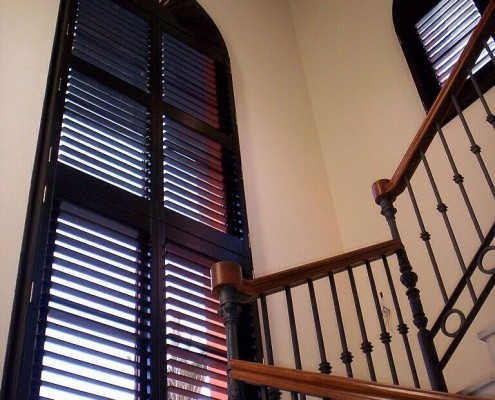 """compass shaped shutters tall hall window in dark brow""n"