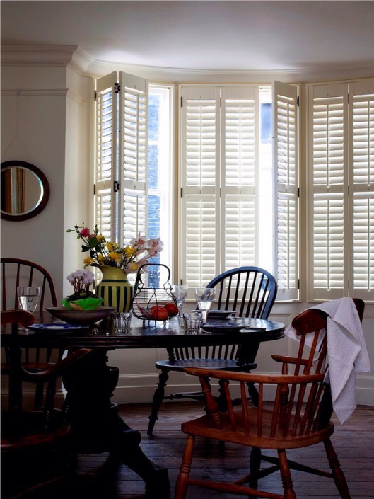 """full height panel shutters dining room in cream"""