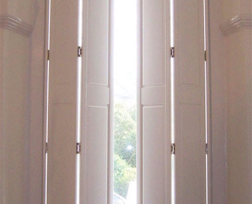 """cream panel solid shutters"""