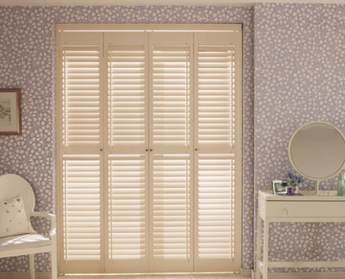 """tracked shutters in cream """