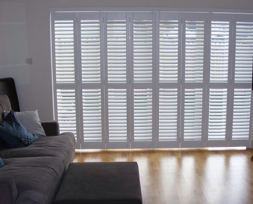 """white tracked shutters"""